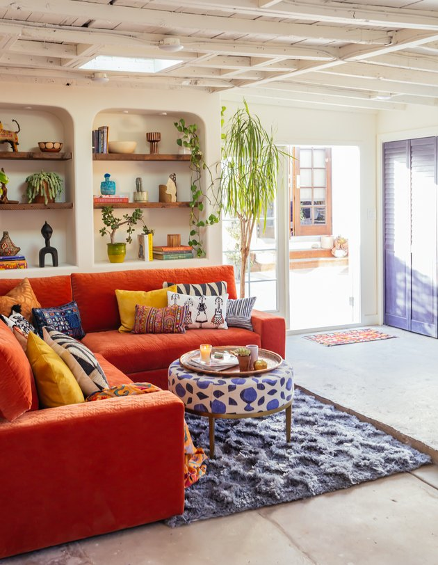 Garage Organization Tips and Tricks with orange couch and built-ins