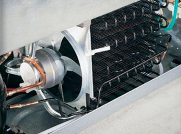 Sealed refrigerator condenser coils.
