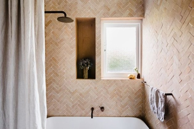 combined bathroom shower idea and bathtub idea with herringbone wall tile