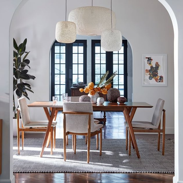Ceiling Fixture Dining Room Lighting idea above wood table with chairs