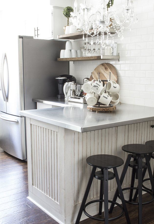 farmhouse kitchen with stainless steel countertops and white subway tile backsplash