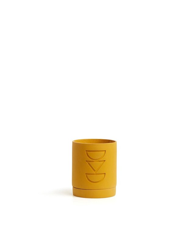 mustard colored carved plant pot