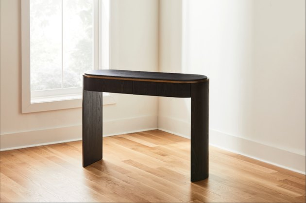 black oval console table