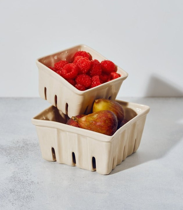 two ceramic berry baskets with fruit