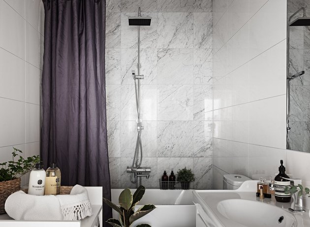 small bathroom idea with marble wall tile in shower and plants