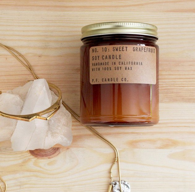 soy wax candle with cotton wick in amber jar