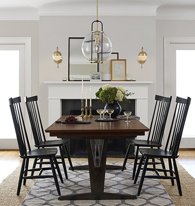 dining room lighting idea with pendant over table and wall sconces at fireplac e