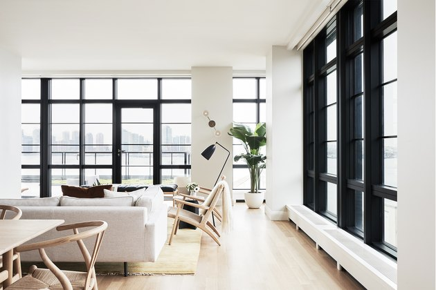 white living room with floor to ceiling windows