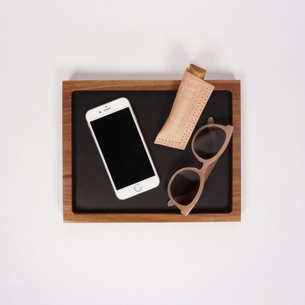 catchall tray made from solid walnut and inset leather