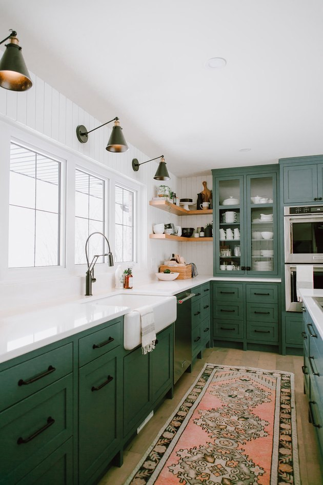 green kitchen cabinet design with farmhouse sink and open shelving