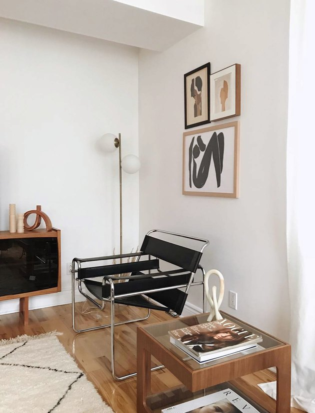 minimal living room with bauhaus chair and small gallery wall