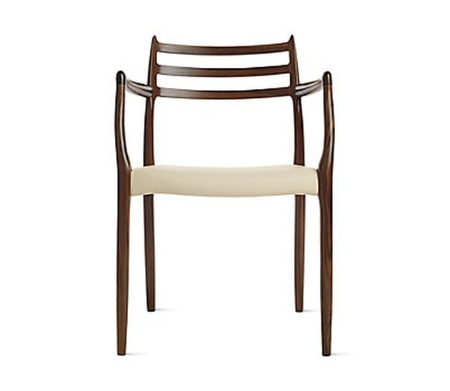 chair with brown legs and beige seat