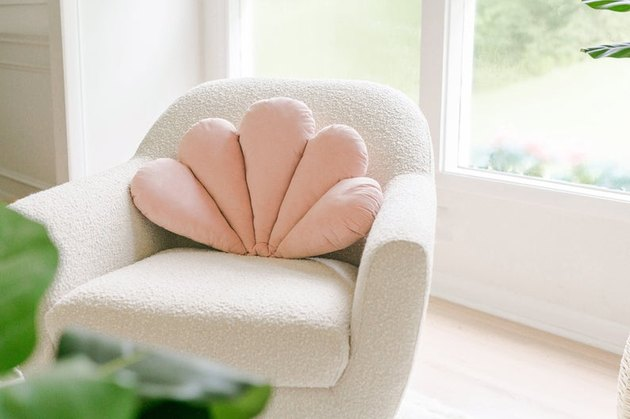 chair with pink shell pillow