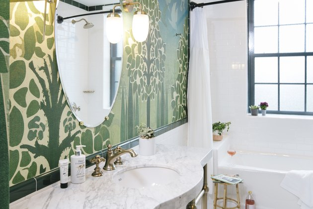 green wallpaper in bathroom