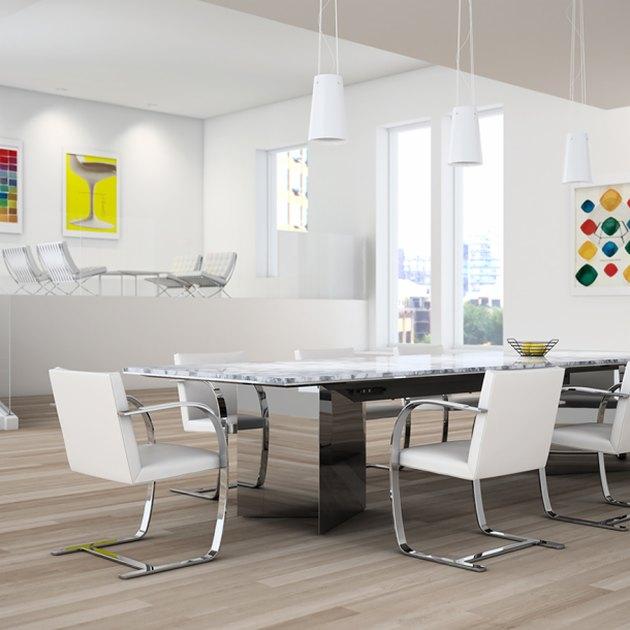 white Bauhaus chair at chrome dining table