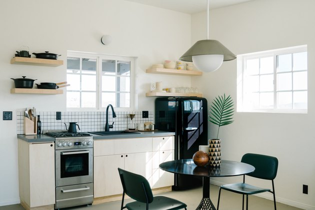 Small kitchen with black SMEG refrigerator
