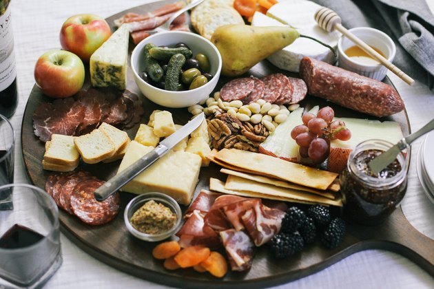 charcuterie spread with cheeses and meats on a tabletop