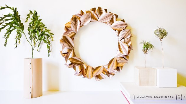 rose gold painted leaves make up this festive fall wreath