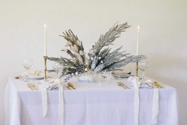 Silver holiday floral centerpiece with pampas grass