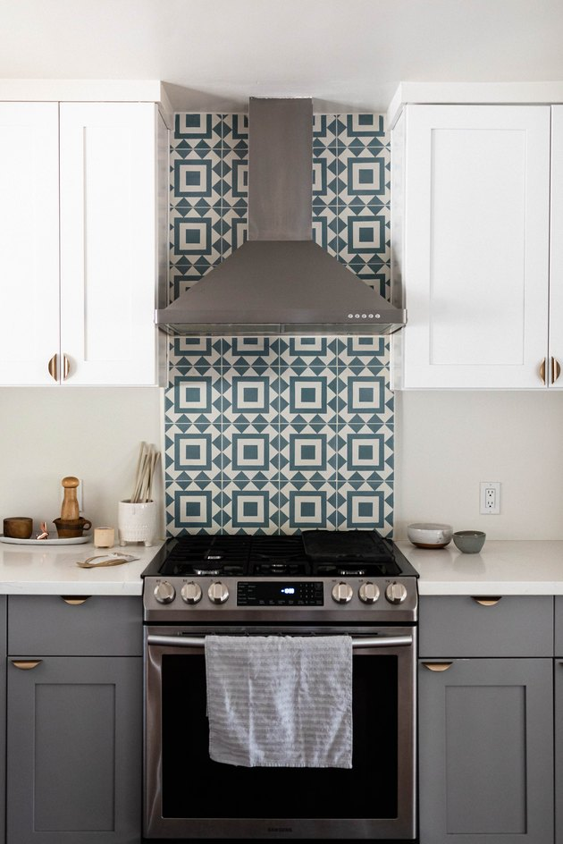 Blue and white Cle Tiles behind stove in kitchen.
