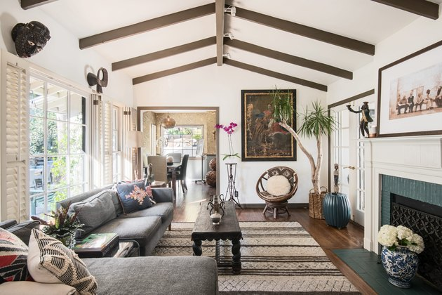 Bohemian living room with gray furniture and wood beams
