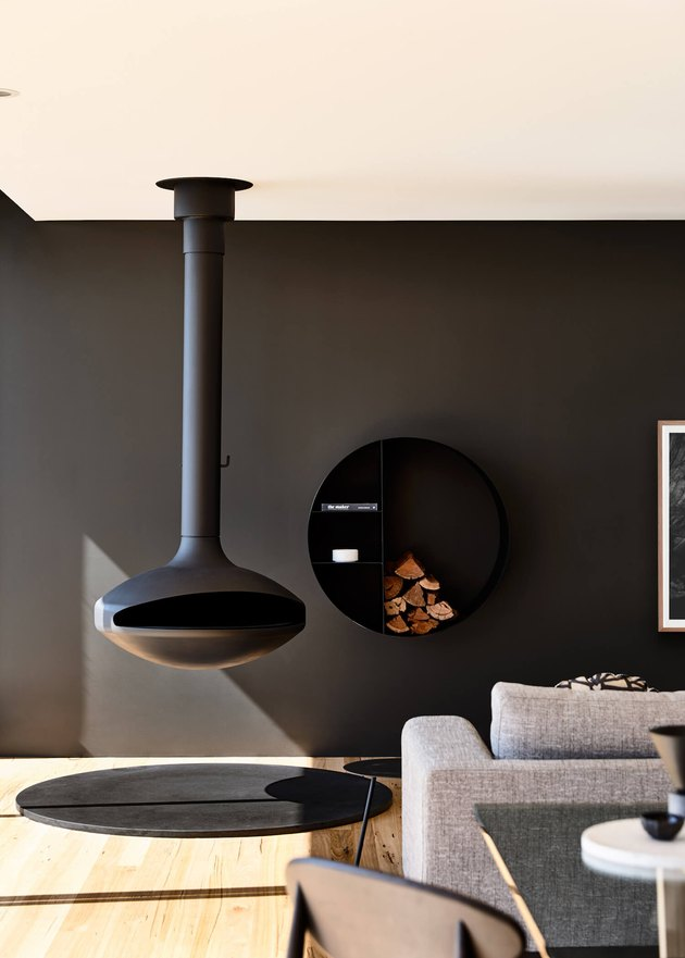 modern home with black hanging fireplace
