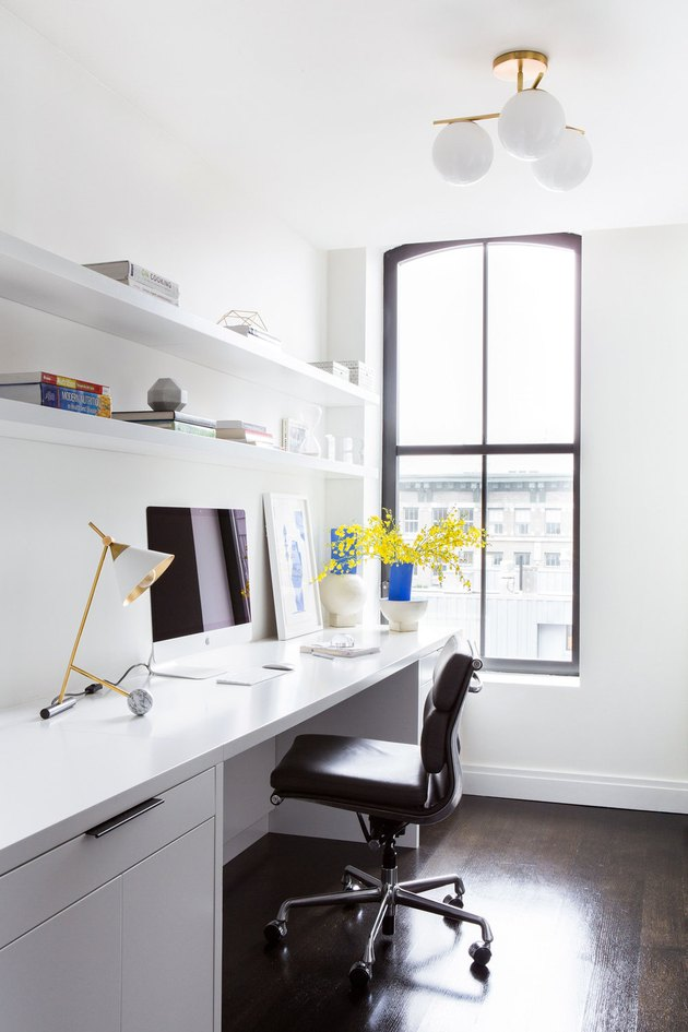 white home office idea with desk and large window