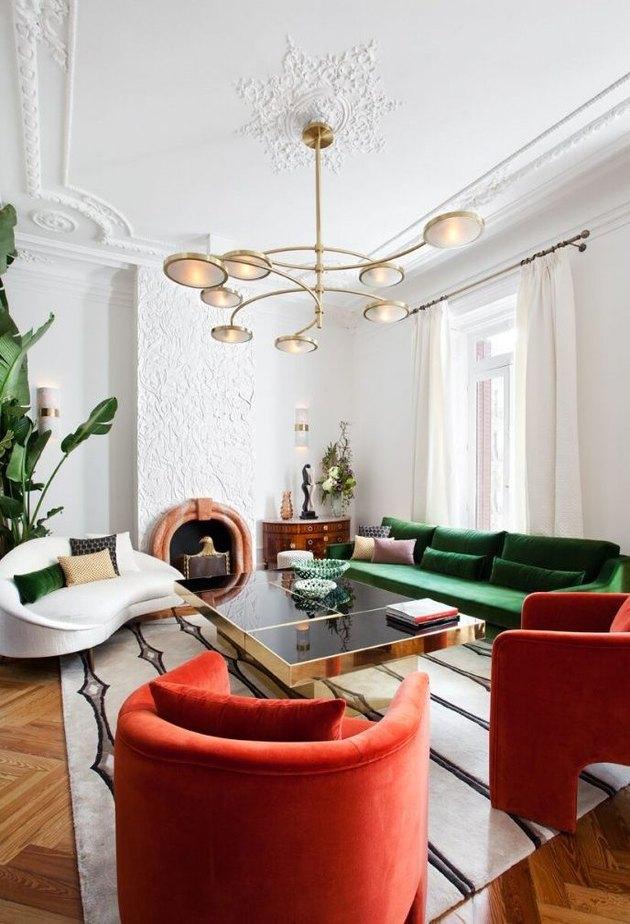 Velvet green sofa with red velvet lounge chairs