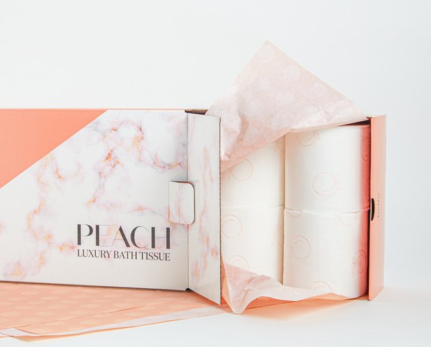 "toilet paper package with text that reads ""peach luxury bath tissue"""