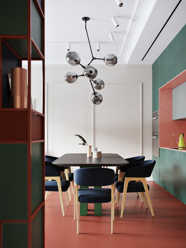 green walls and rust color flooring and shelving units