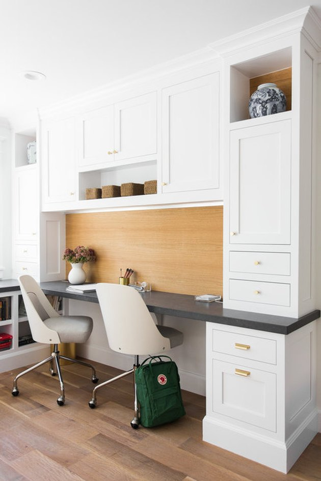 white home office idea with desk, chair, and cabinets