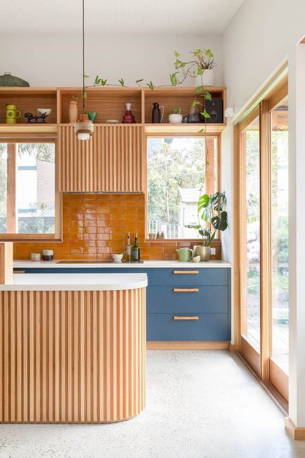 wooden kitchen cabinetry with cantaloupe orange tiling
