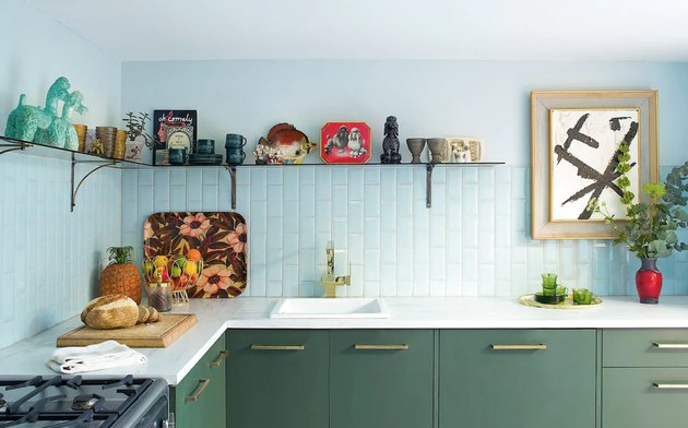 purish blue kitchen with blue tiles and green cabinetry