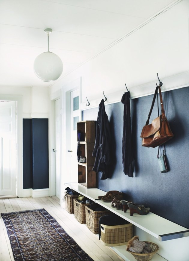 A mudroom with dark blue walls