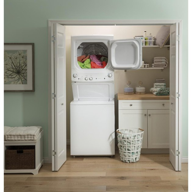 Compact washer and dryer in closet.