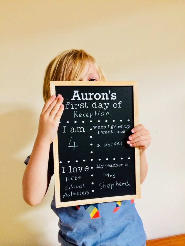 kid with chalkboard