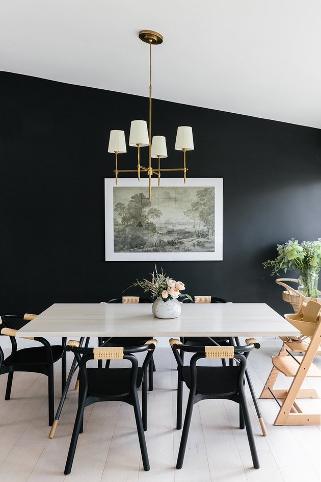 black dining room color idea with white sloped ceiling
