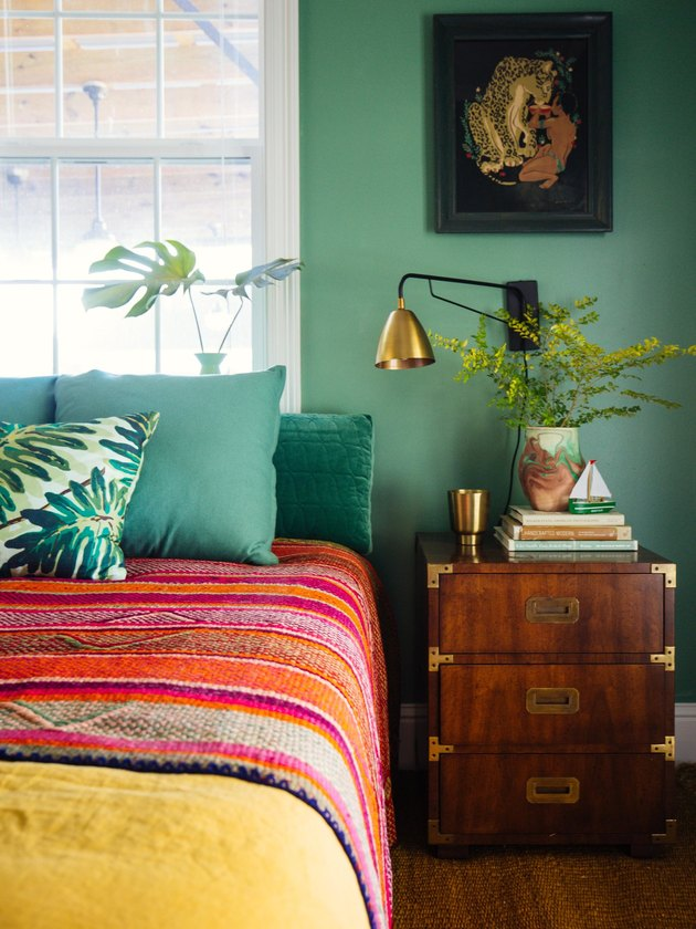 green bedroom with red Southwestern blanket