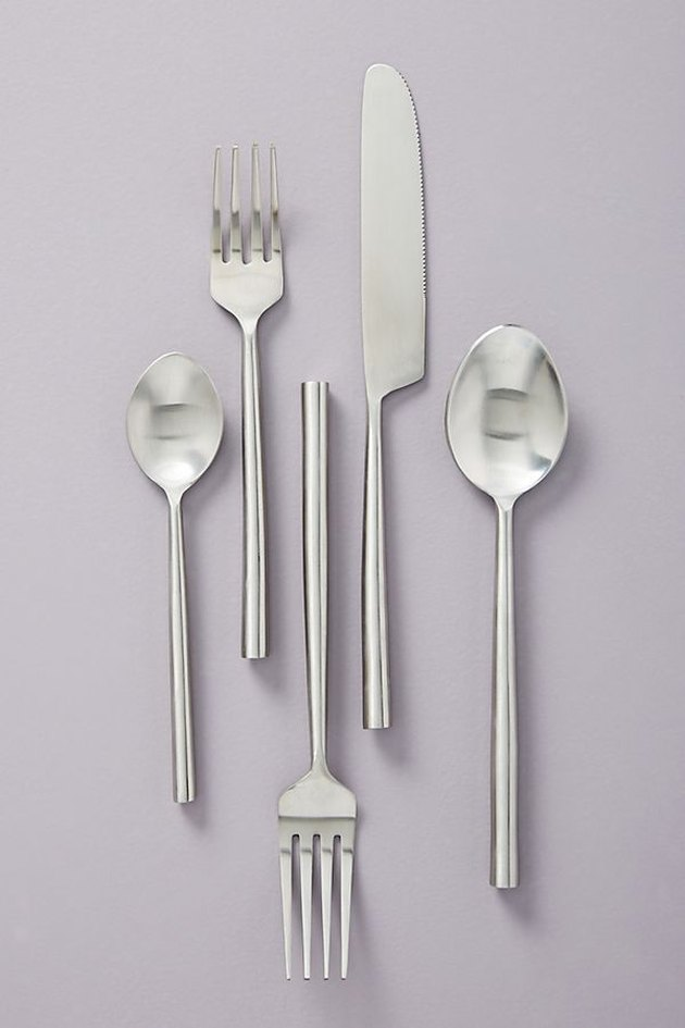 flatware set with forks, knives, and spoons