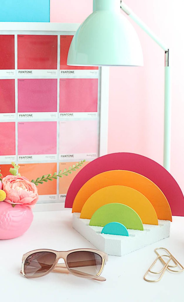 A rainbow desk organizer and brightly colored desk