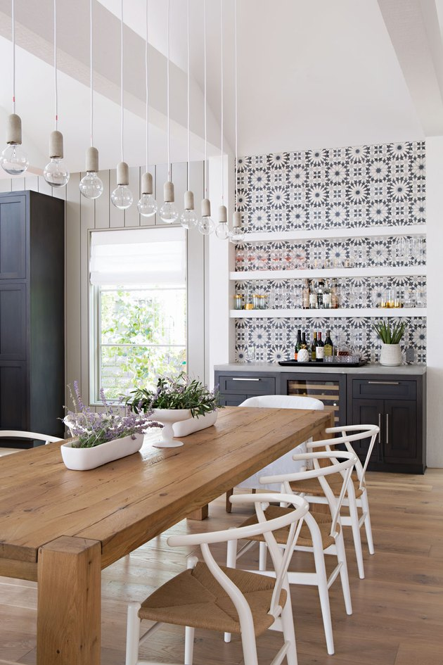 gray and white kitchen with patterned tiles and white accessories