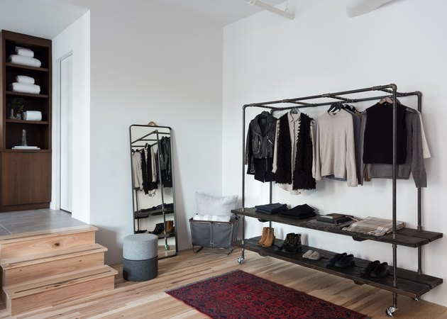 bedroom with clothing rack storage