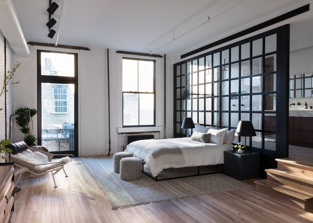industrial bedroom with glass wall partition