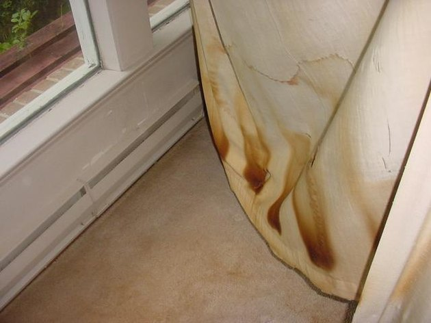 Baseboard heater and scorched drapery