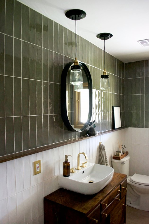 Modern bathroom with green and white bathroom tile