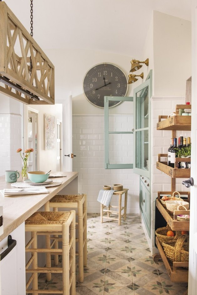 white rustic kitchen with aqua cabinet and wood furniture