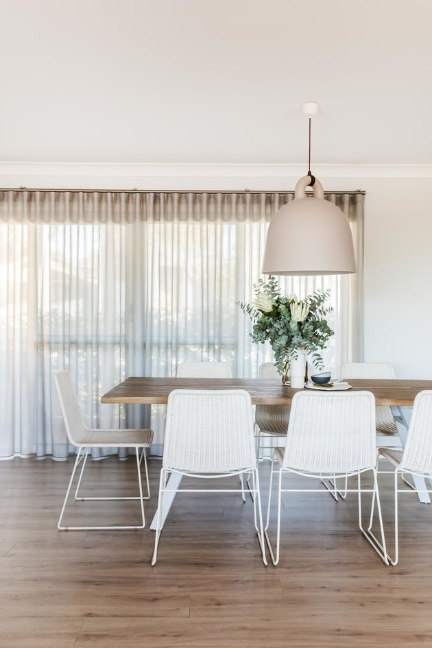 white dining room lighting idea with oversize minimal pendant