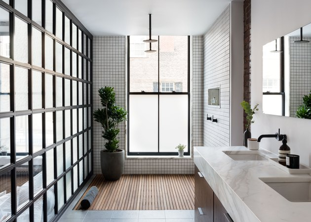 bathroom with open shower and tiled walls