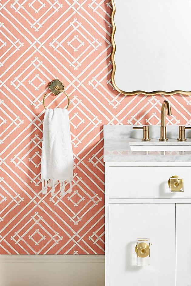 peach patterned wallpaper in bathroom space