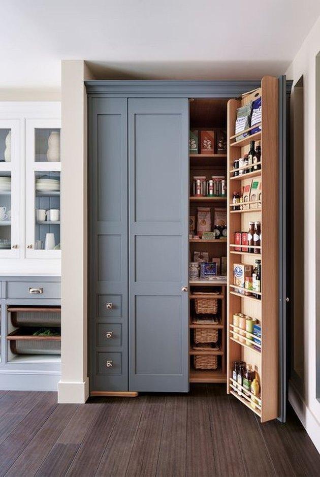 organized small pantry closet with door storage